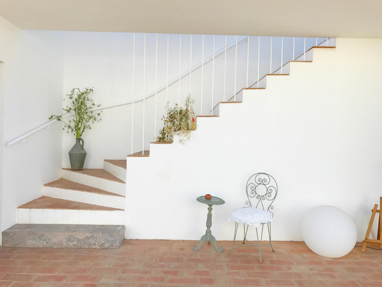 Die Treppe zu den oberen Zimmern im Casa Modesta.