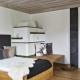 Appartement 2 - Wohnzimmer mit Kamin