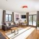 Das Wohnzimmer des Appartements Erde im Naturchalet