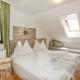 Betten in einer Ferienwohnung im Landgasthof Bergrast - Schlafen mit Aussicht!