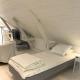 Der Schlafbereich im Loft-Apartment