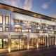 So sieht das schicke Appartementhaus Passepartout im Zentrum Norderneys von außen aus