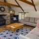 Im Cottage Hayloft habt Ihr einen Kamin